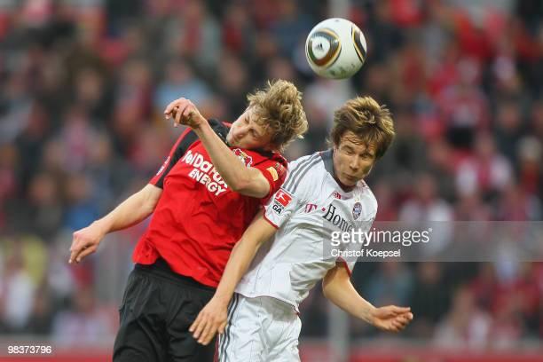 Stefan Kiessling of Leverkusen and Holger Badstuber of Bayern go up for a header during the Bundesliga match between Bayer Leverkusen and FC Bayern...