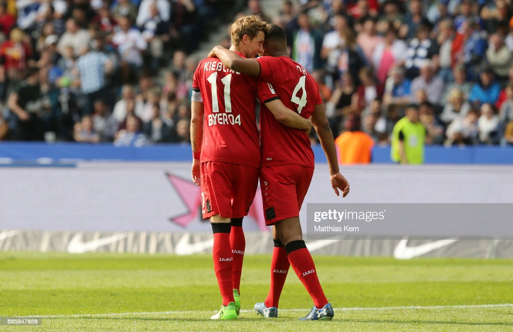 Stefan Kiessling (L) of Leverkusen and Jonathan Tah look on during the Bundesliga match between Hertha BSC and Bayer 04 Leverkusen at Olympiastadion on May 20, 2017 in Berlin, Germany.