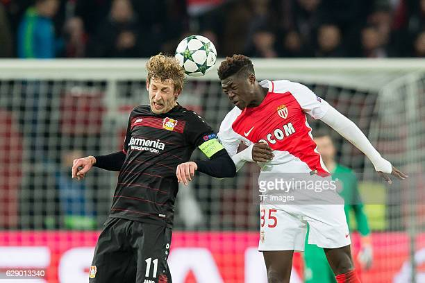 Stefan Kiessling of Leverkusen and Kevin N'Doram of Monaco battle for the ball during the UEFA Champions League match between Bayer Leverkusen and AS...