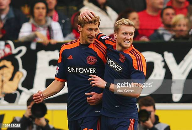 Stefan Kiessling of Leverkusen celebrates his team's first goal with team mate Andre Schuerrle during the Bundesliga match between VfB Stuttgart and...