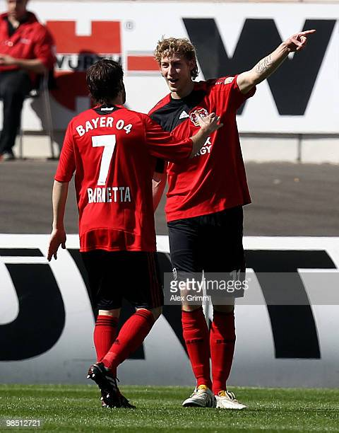 Stefan Kiessling of Leverkusen celebrates his team's first goal with team mate Tranquillo Barnetta during the Bundesliga match between VfB Stuttgart...