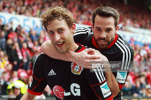 Stefan Kiessling of Leverkusen celebrates his team's second goal with team mate Gonzalo Castro during the Bundesliga match between 1 FSV Mainz 05 and...