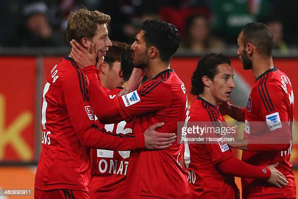 Stefan Kiessling of Leverkusen celebrates scoring the opening goal with his team mate Emre Can ring the Bundesliga match between FC Augsburg and...
