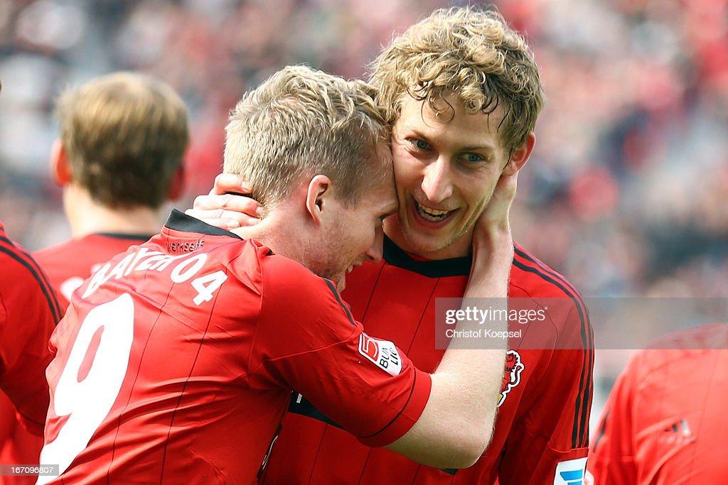 Stefan Kiessling of Leverkusen celebrates the first goal with Andre Schuerrle (L) during the Bundesliga match between Bayer 04 Leverkusen and TSG 1899 Hoffenheim at BayArena on April 20, 2013 in Leverkusen, Germany.