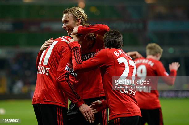 Stefan Kiessling of Leverkusen celebrates with his teammates Simon Rolfes and Gonzalo Castro after scoring his team's second goal during the...