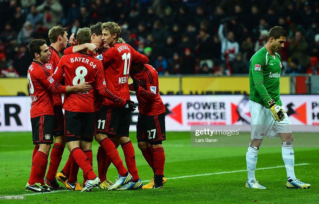 Stefan Kiessling of Leverkusen celebrates with team mates after scoring his teams second goal during the Bundesliga match between Bayer 04 Leverkusen and Eintracht Frankfurt at BayArena on January 19, 2013 in Leverkusen, Germany.