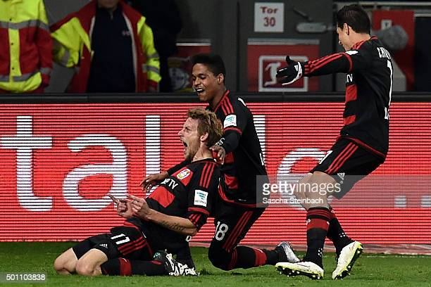 Stefan Kiessling of Leverkusen celebrates with team mates after scoring the opening goal during the Bundesliga match between Bayer Leverkusen and...
