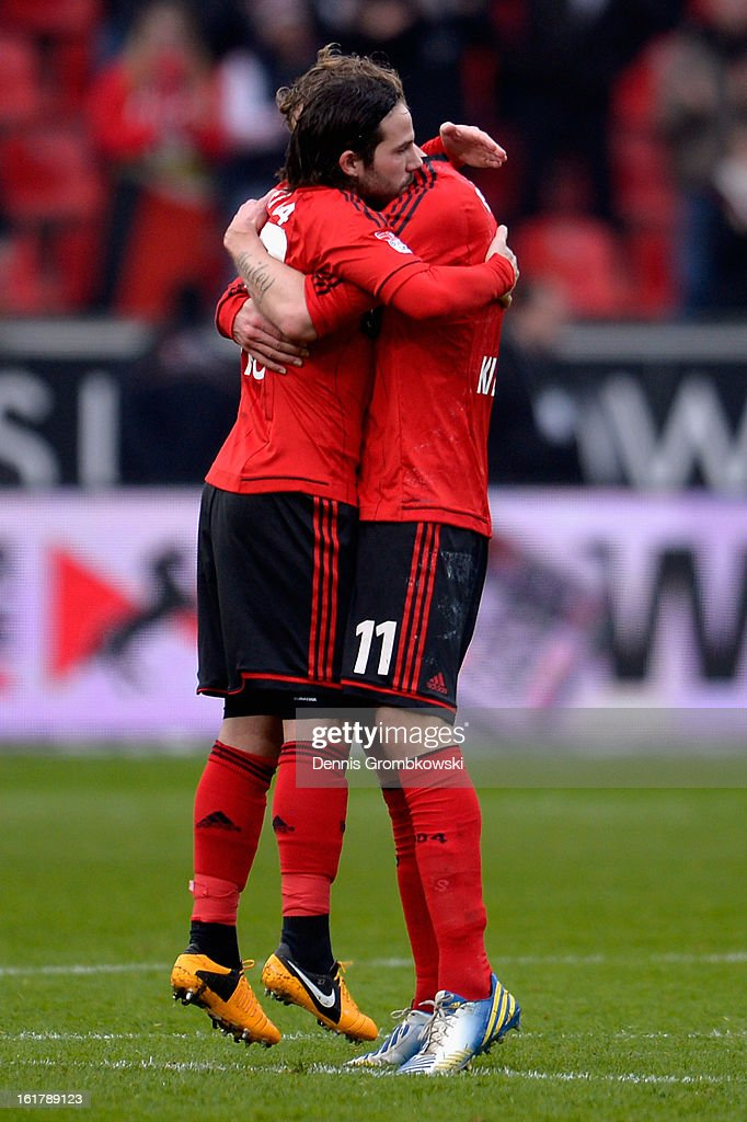 Stefan Kiessling of Leverkusen celebrates with teammate Ramos Carvajal after scoring his team's first goal during the Bundesliga match between Bayer 04 Leverkusen and FC Augsburg at BayArena on February 16, 2013 in Leverkusen, Germany.