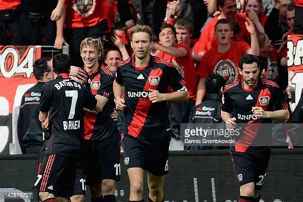 Stefan Kiessling of Leverkusen celebrates with teammates after scoring his team's second goal during the Bundesliga match between Bayer 04 Leverkusen...