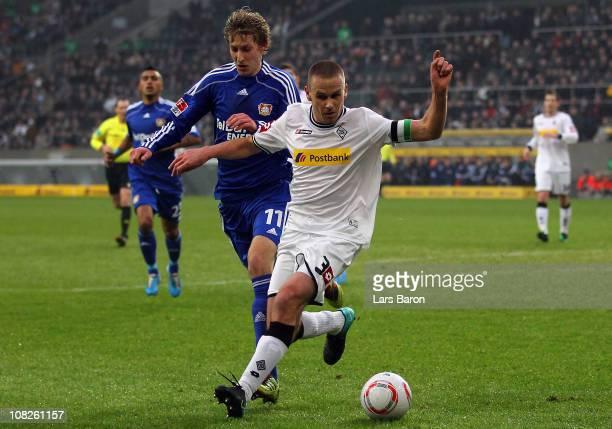 Stefan Kiessling of Leverkusen challenges Filip Daems of Moenchengladbach during the Bundesliga match between Borussia Moenchengladbach and Bayer...