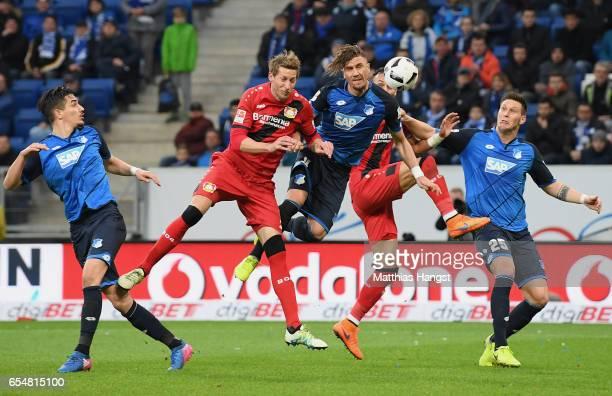 Stefan Kiessling of Leverkusen Ermin Bicakcic of Hoffenheim Oemer Toprak of Leverkusen and Niklas Suele of Hoffenheim compete for the ball during the...