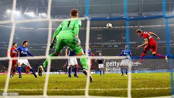 Stefan Kiessling of Leverkusen heads the opening goal during the Bundesliga match between FC Schalke 04 and Bayer 04 Leverkusen at VeltinsArena on...