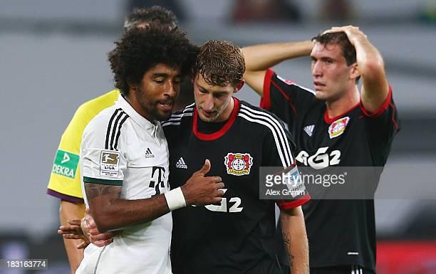 Stefan Kiessling of Leverkusen hugs Dante of Muenchen during the Bundesliga match between Bayer Leverkusen and FC Bayern Muenchen at BayArena on...