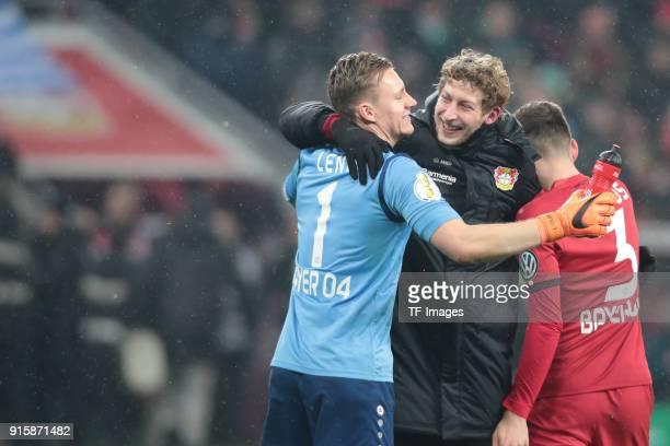 Stefan Kiessling of Leverkusen hugs Goalkeeper Bernd Leno of Leverkusen and Panagiotis Retsos after the DFB Cup match between Bayer Leverkusen and...