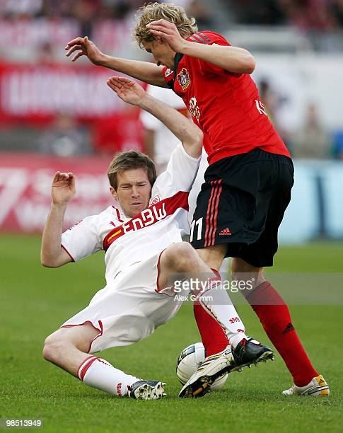 Stefan Kiessling of Leverkusen is challenged by Aliaksandr Hleb of Stuttgart during the Bundesliga match between VfB Stuttgart and Bayer Leverkusen...
