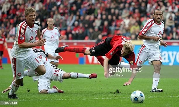 Stefan Kiessling of Leverkusen is challenged by Javier Pinola and Jawhar Mnari of Nuernberg during the Bundesliga match between Bayer Leverkusen and...