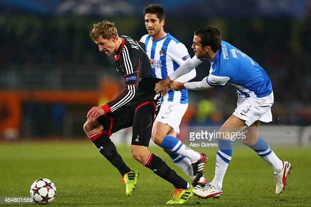 Stefan Kiessling of Leverkusen is challenged by Mikel Gonzalez of Real Sociedad during the UEFA Champions League Group A match between Real Sociedad...
