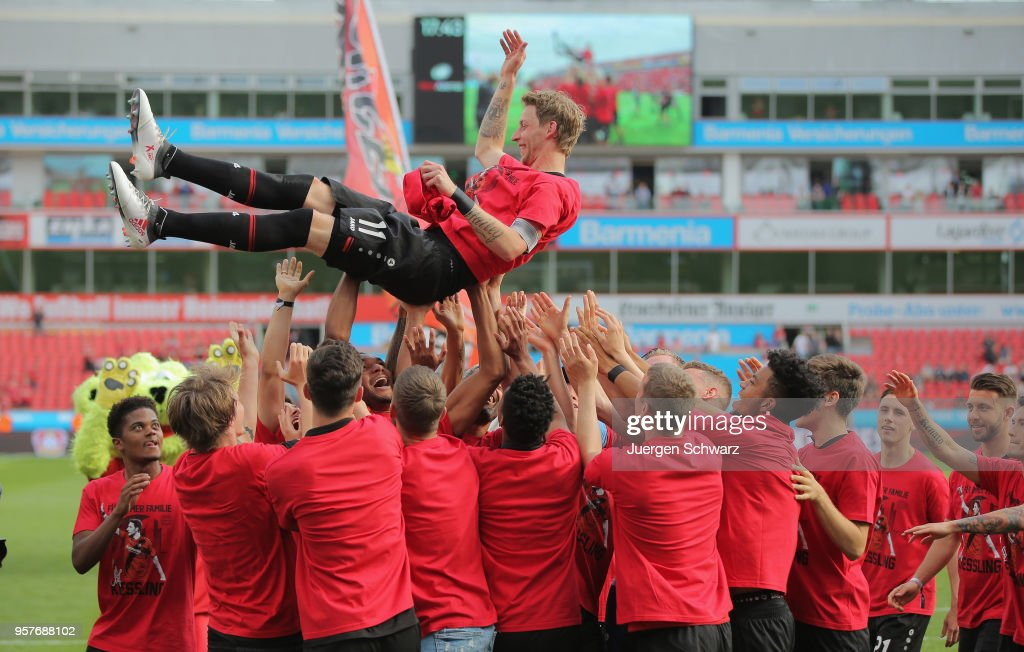Stefan Kiessling of Leverkusen is thrown in the air after the Bundesliga match between Bayer 04 Leverkusen and Hannover 96 at BayArena on May 12, 2018 in Leverkusen, Germany.