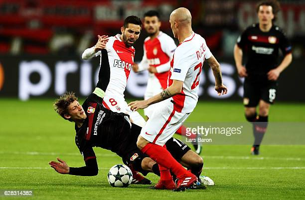 Stefan Kiessling of Leverkusen Joao Mautinho and Andrea Raggi of Monaco battle for the ball during the UEFA Champions League match between Bayer 04...