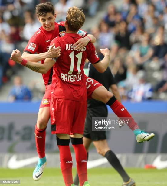 Stefan Kiessling of Leverkusen jubilates with team mate Kai Havertz after scoring the fourth goal during the Bundesliga match between Hertha BSC and...