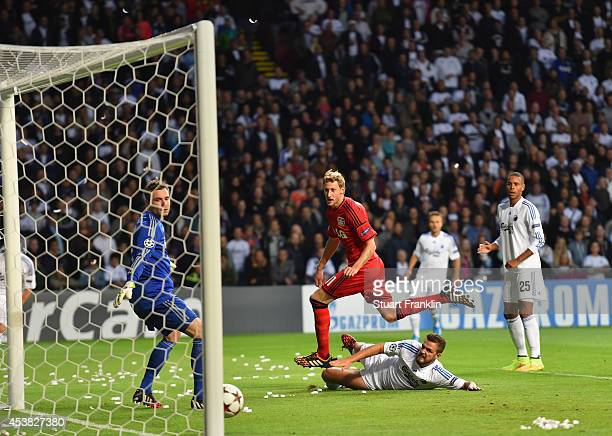 Stefan Kiessling of Leverkusen scores the first goal during the first leg of the UEFA Champions league qualifying playoff match between FC Copenhagen...