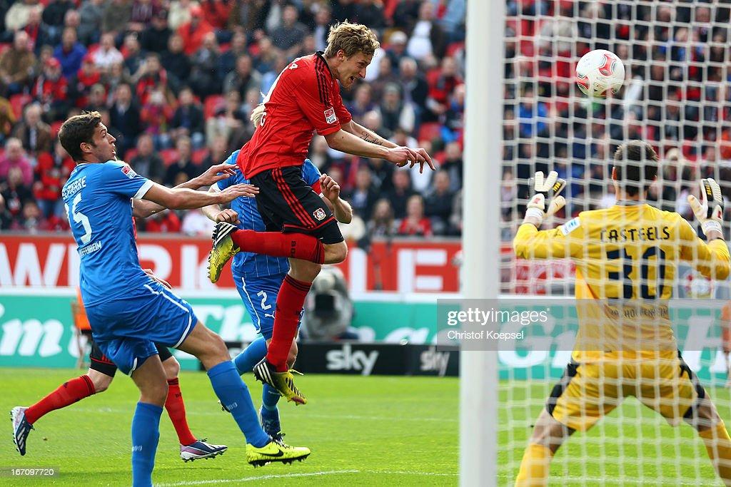 Stefan Kiessling of Leverkusen (C) scores the third goal against Matthieu Delpierre of Hoffenheim (L) and Koen Casteels of Hoffenheim (R) during the Bundesliga match between Bayer 04 Leverkusen and TSG 1899 Hoffenheim at BayArena on April 20, 2013 in Leverkusen, Germany.