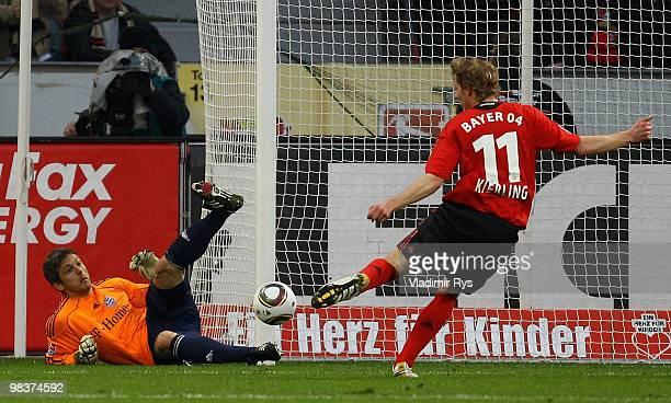 Stefan Kiessling of Leverkusen shoots as Joerg Butt of Bayern lays on the pitch during the Bundesliga match between Bayer Leverkusen and FC Bayern...