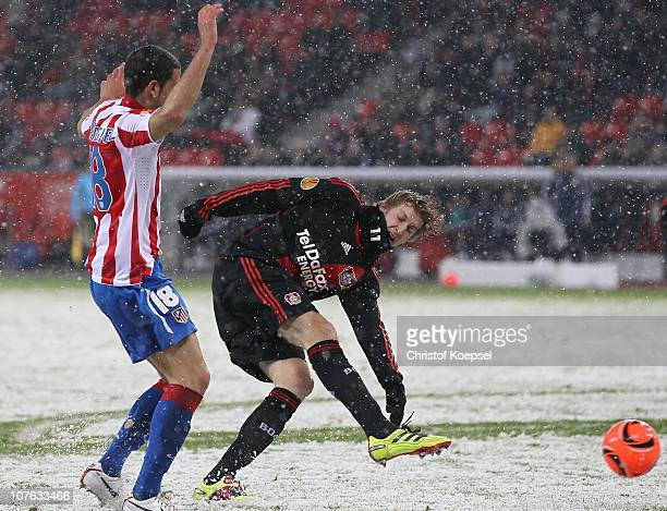 Stefan Kiessling of Leverkusen shoots the ball against Alvaro Dominguez of Atletico during the UEFA Europa League Group B match between Bayer...