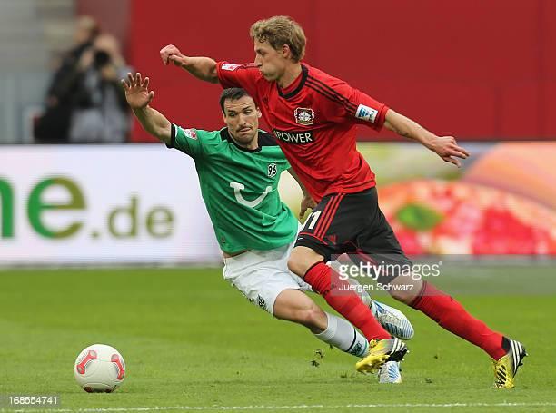 Stefan Kiessling of Leverkusen tackles Mario Eggimann of Hannover during the Bundesliga match between Bayer 04 Leverkusen and Hannover 96 at BayArena...
