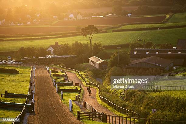 Stefan Kirwan riding Royal Milan is a lone figure ahead of first lot at Sandhill Racing Stables on September 16 2015 in Minehead England Sandhill...