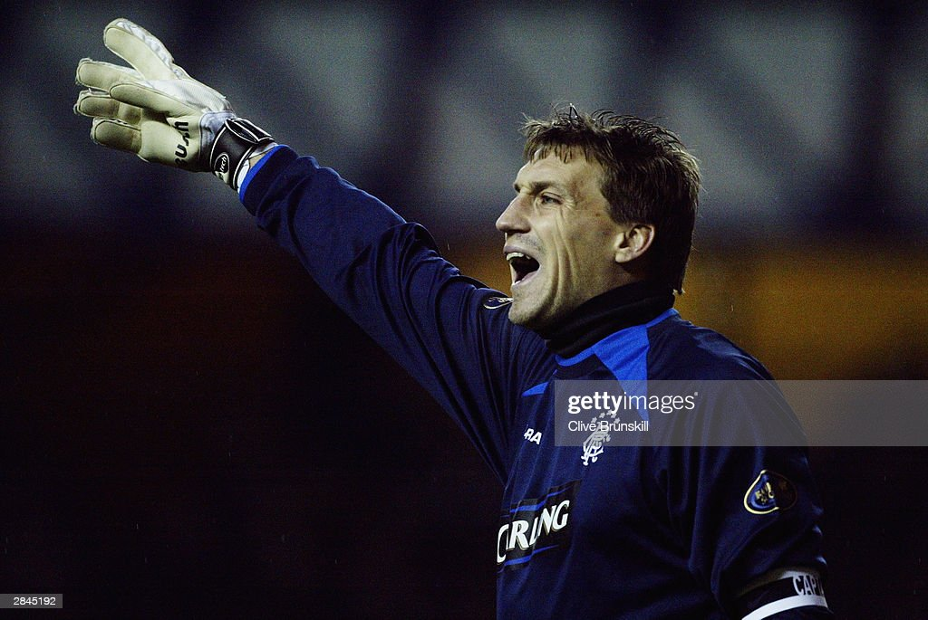 Stefan Klos of Rangers signals to a team mate during the Bank of Scotland Scottish Premier League match between Rangers and Hearts on December 20, 2003 at Ibrox in Glasgow, Scotland. Rangers won the match 2-1.