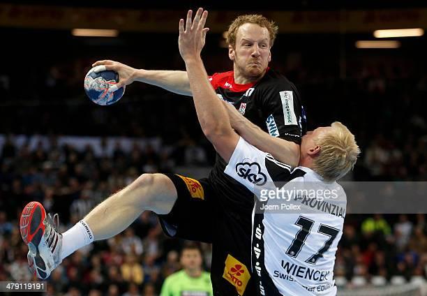 Stefan Kneer of Magedeburg is challenged by Patrick Wiencek of Kiel during the Bundesliga handball match between THW Kiel and SC Magdeburg at the...