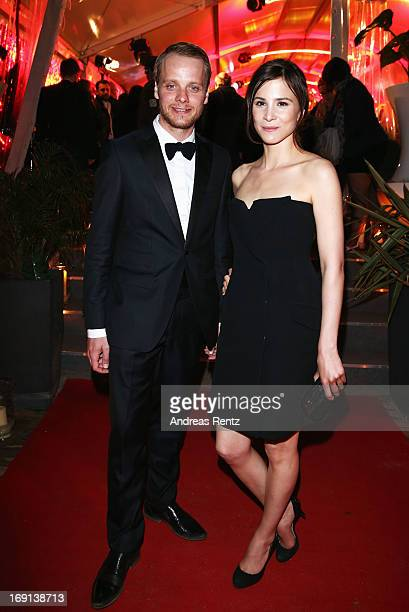 Stefan Konarske and Aylin Tezel attend the German Films reception during the 66th Annual Cannes Film Festival at the Majestic Beach on May 20 2013 in...