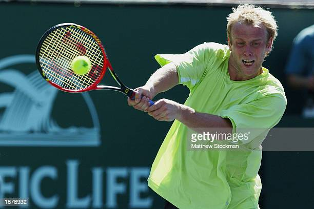 Stefan Koubek of Austria returns a shot to Marat Safin of Russia during the Pacific Life Open March 10 2003 at the Indian Wells Tennis Garden in...