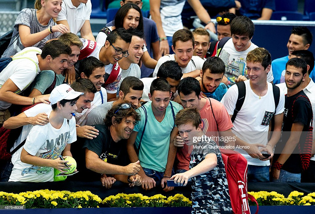 Stefan Kozlov of the United States takes a selfie with the fans after his match against Martin Klizan of Slovakia during day one of the ATP 500 World Tour Valencia Open tennis tournament at the Ciudad de las Artes y las Ciencias on October 20, 2014 in Valencia, Spain.
