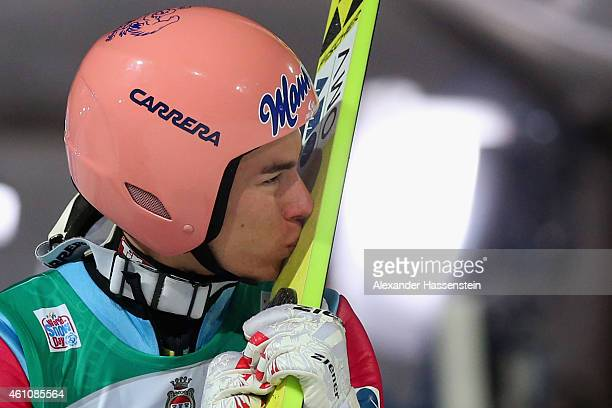 Stefan Kraft of Austria celebrates winning the Four Hills Tournament Ski Jumping event on day 8 of the Four Hills Tournament Ski Jumping event at...
