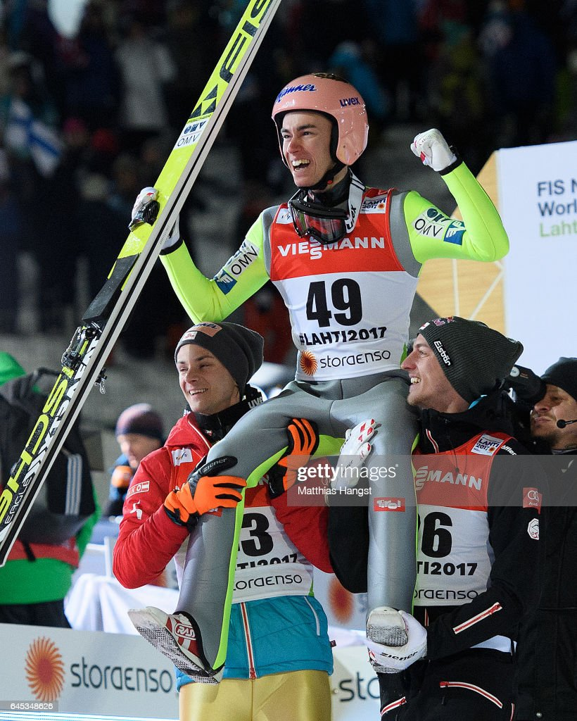 Stefan Kraft (T) of Austria celebrates with his teammates Manuel Fettner (L) of Austria and Gregor Schlierenzauer (R) of Austria after his final jump in the Men's Ski Jumping HS100 Final during the FIS Nordic World Ski Championships on February 25, 2017 in Lahti, Finland.