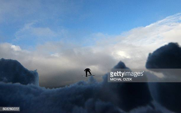 Stefan Kraft of Austria competes during the Four Hills competition of the FIS Ski Jumping World Cup in Innsbruck on January 3 2016 Peter Prevc of...