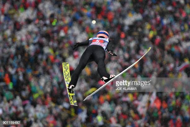 Stefan Kraft of Austria jumps during the ski jumping event of the third stage at the 66th Four Hills Tournament in Innsbruck Austria on January 4...
