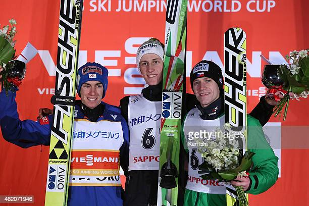 Stefan Kraft of Austria second place Peter Prevc of Slovenia first place and Roman Koudelka of Czech Republic pose for photos on the podium after the...