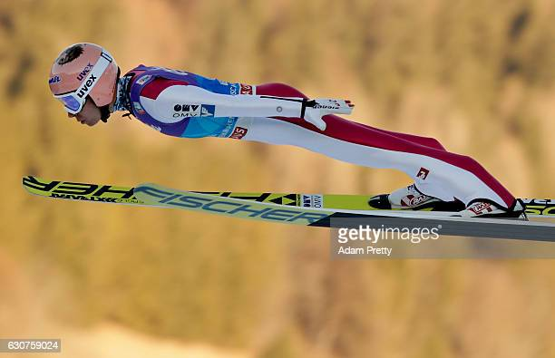 Stefan Kraft of Austria soars through the air during his first competition jump on Day 2 of the 65th Four Hills Tournament ski jumping event on...