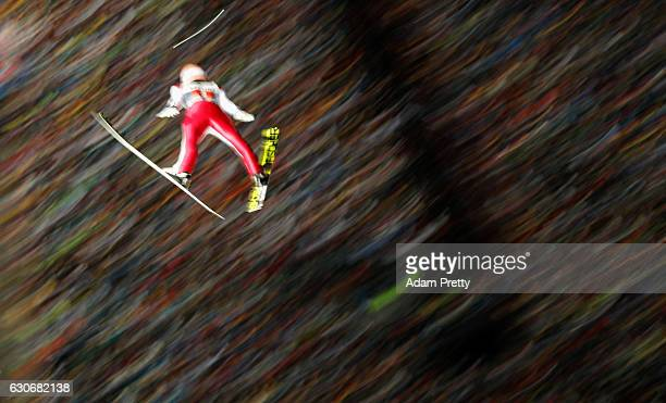 Stefan Kraft of Austria soars through the air during his second competition jump on Day 2 of the 65th Four Hills Tournament ski jumping event on...