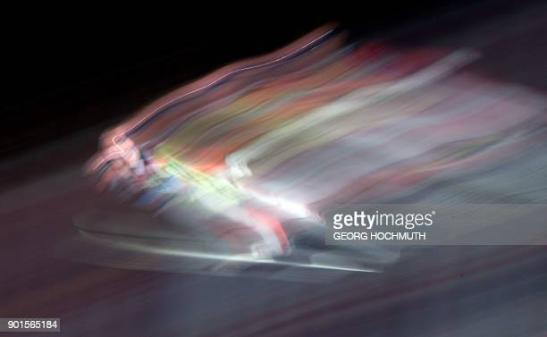Stefan Kraft of Austria soars through the air during the qualification for the fourth and final stage of the Four-Hills Ski Jumping tournament in...