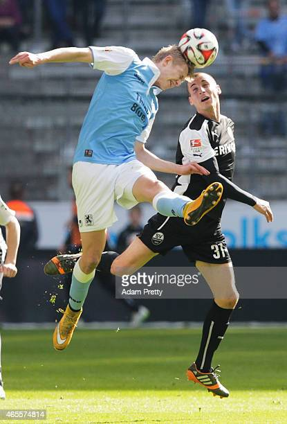 Stefan Kulovits of SV Sandhausen challenges Jannik Bandowski of 1869 Muenchen during the 2 Bundesliga match between 1860 Muenchen and SV Sandhausen...