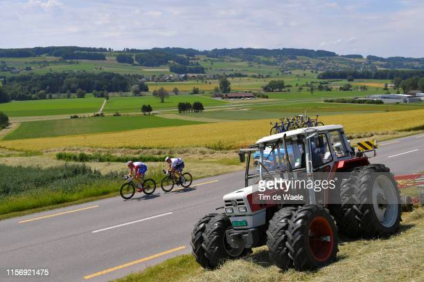 Stefan Kung of Switzerland and Team Groupama - FDJ / Matej Mohoric of Slovenia and Team Bahrain - Merida / Agricultural Tractor / Landscape / during...
