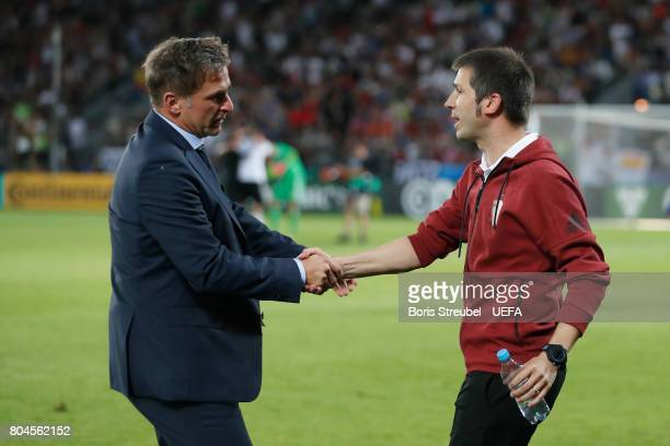 Stefan Kuntz coach of Germany and Albert Celades of Spain shake hands following the UEFA European Under21 Championship Final between Germany and...