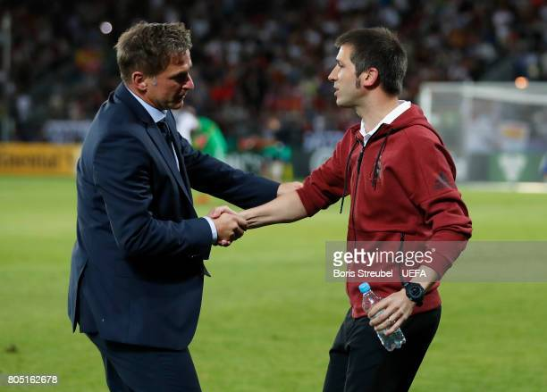 Stefan Kuntz coach of Germany and Albert Celades of Spain shake hands following the UEFA European Under21 Championship Final match between Germany...