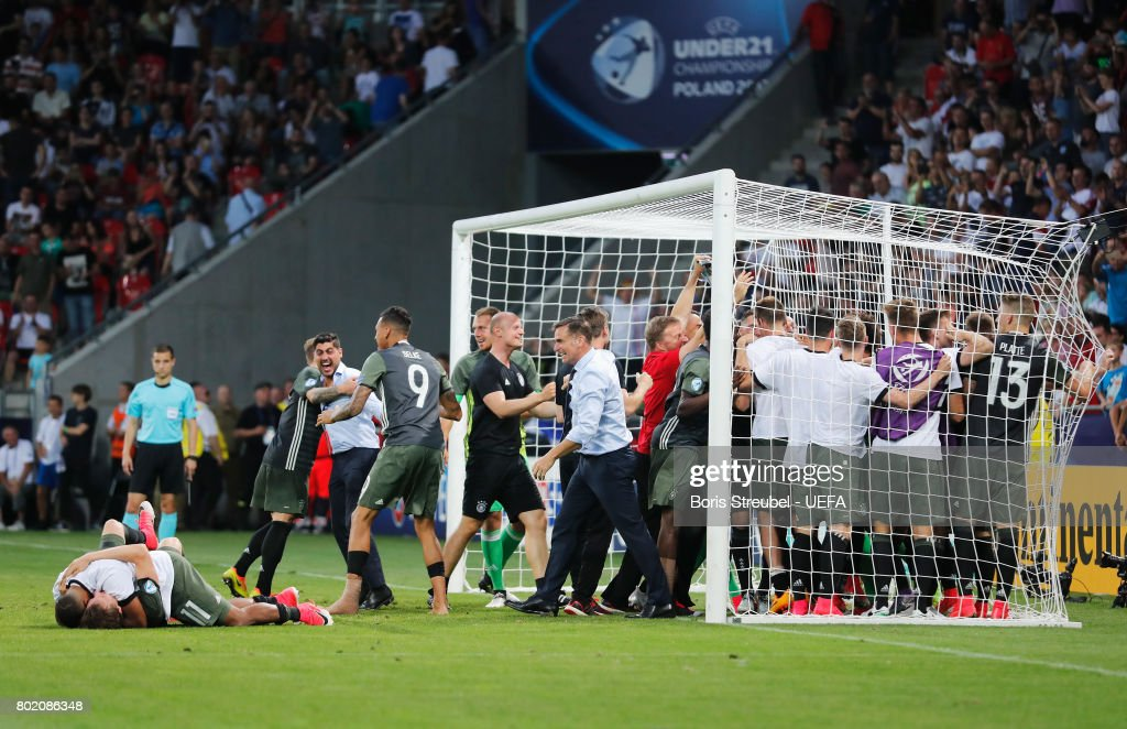 Stefan Kuntz, coach of Germany and his Germany team celebrate winning the penatly shoot out after the UEFA European Under-21 Championship Semi Final match between England and Germany at Tychy Stadium on June 27, 2017 in Tychy, Poland.