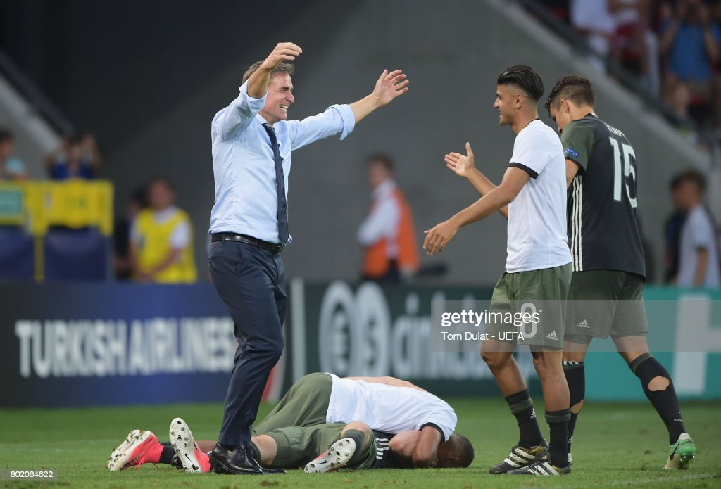 Stefan Kuntz, coach of Germany celebrates winning a penalty shoot out with Mahmoud Dahoud of Germany during the UEFA European Under-21 Championship Semi Final match between England and Germany at Tychy Stadium on June 27, 2017 in Tychy, Poland.