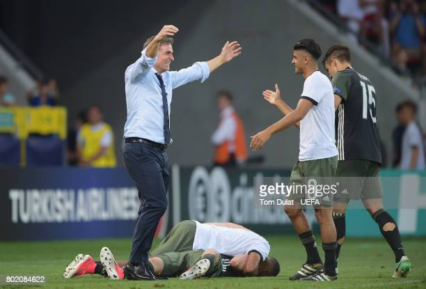 Stefan Kuntz coach of Germany celebrates winning a penalty shoot out with Mahmoud Dahoud of Germany during the UEFA European Under21 Championship...